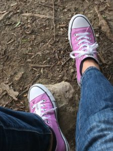 feet in purple converse looking down from above