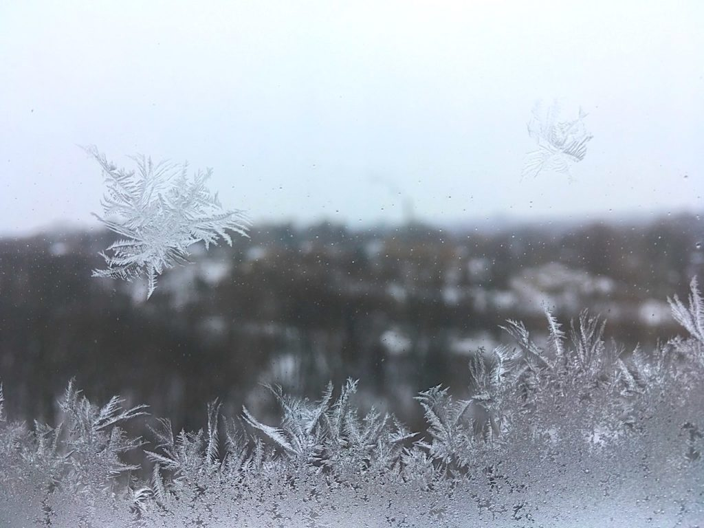 frost superimposed on window looking out over city of London, Ontario