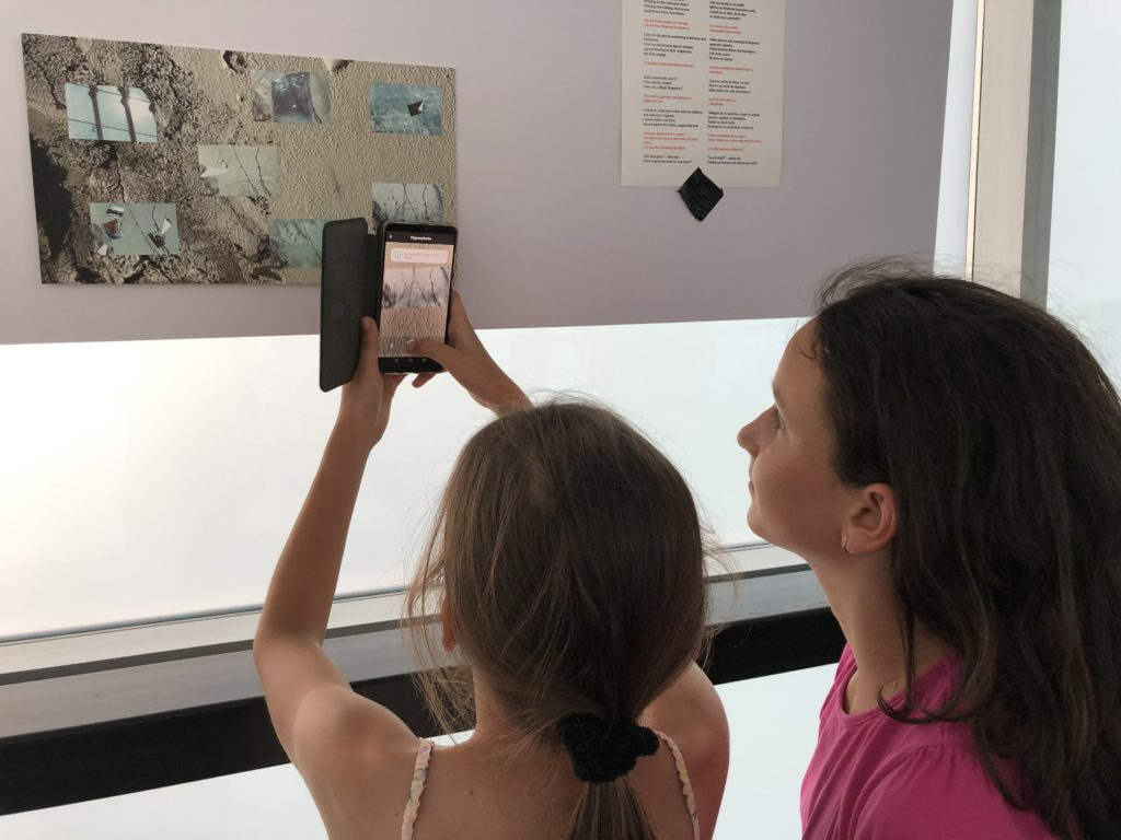 2 young Serbian girls interact with the Augmented Reality installation, Still/ed Here